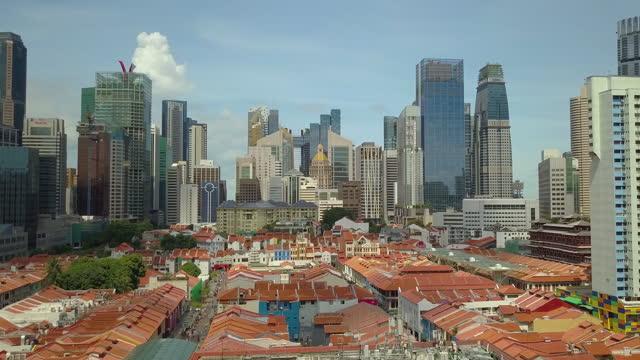 4k aerial view singapore skyline and china town - noelia ramon stock videos & royalty-free footage