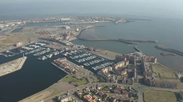 aerial view slow orbit of hartlepool marina from inland - jetty stock videos & royalty-free footage