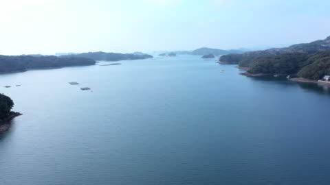 vídeos y material grabado en eventos de stock de aerial view small islands on the sea - perspectiva desde un helicóptero