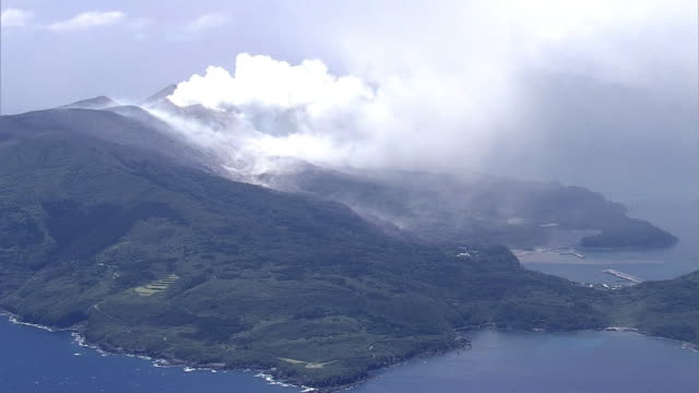 Aerial view Smoke plume coming out of Mount Shindake Long shot of the island