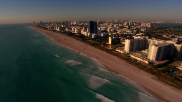 aerial view south along coastline and beach  to government cut / miami beach, florida - lifeguard chair stock videos & royalty-free footage