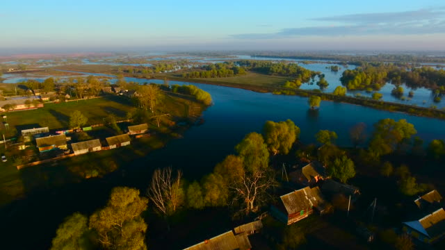 Aerial View. Spilling of the Pripyat River. Village in the early morning. Aerial drone shot.