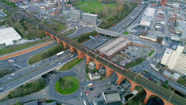 aerial view stockport viaduct intercity and local train crossing towards station over roads and river mersey - aerial view stock videos & royalty-free footage