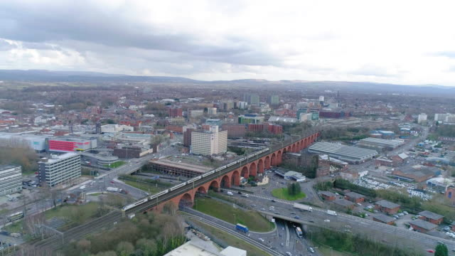 aerial view stockport viaduct intercity train crossing towards station - manchester england stock videos & royalty-free footage