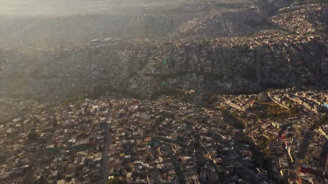 Aerial view, sun shines over urban landscape in Mexico City
