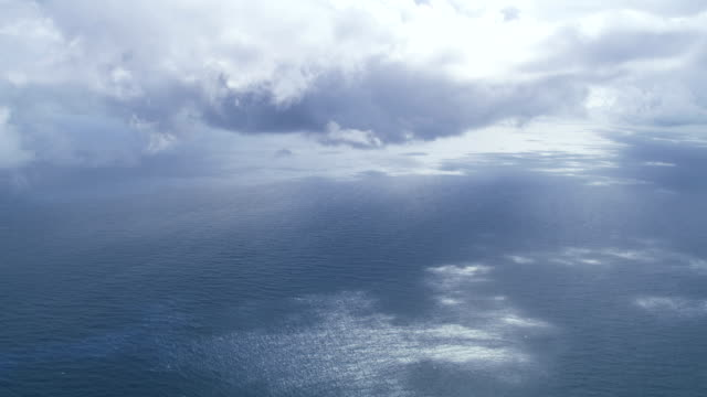 Aerial view sunlight reflecting on Pacific ocean seascape