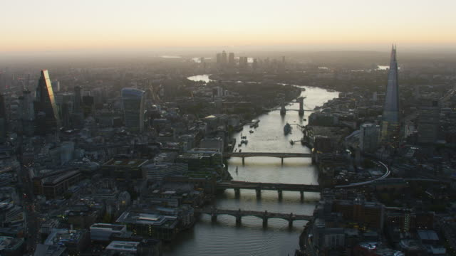 aerial view sunrise over canary wharf london uk - skyline stock videos & royalty-free footage