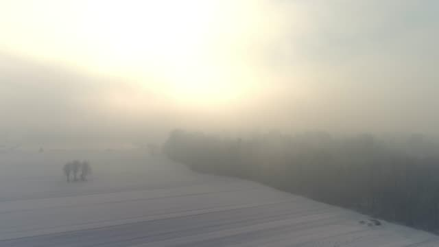 ws aerial view sunrise over tranquil,idyllic fog over snowy rural landscape,slovenia - 30 seconds or greater stock videos & royalty-free footage