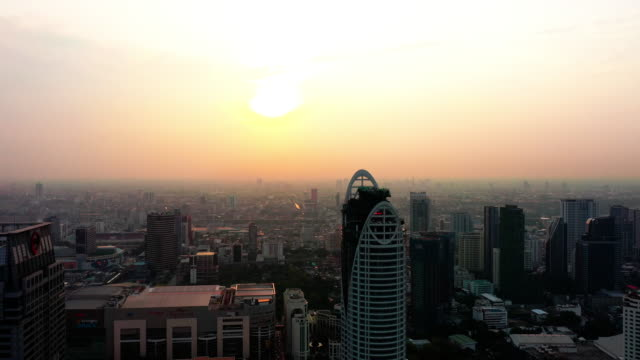 aerial view sunset of bangkok at thailand - high street stock videos & royalty-free footage