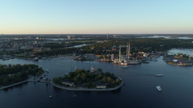 Aerial view, sunset over Stockholm. Skeppsholmen and , ferry, ferries going from Djurgarden