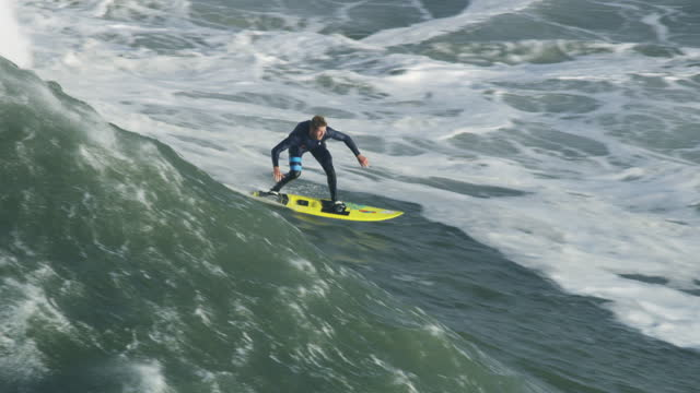 aerial view surfer on extreme wave mavericks usa - northern california stock videos & royalty-free footage