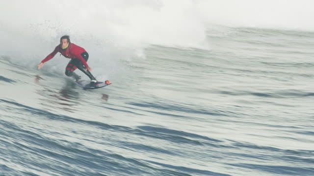 aerial view surfer on large wave mavericks usa - northern california stock videos & royalty-free footage