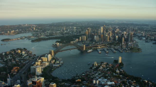 vídeos de stock, filmes e b-roll de aerial view sydney harbor bridge and opera house - sydney australia