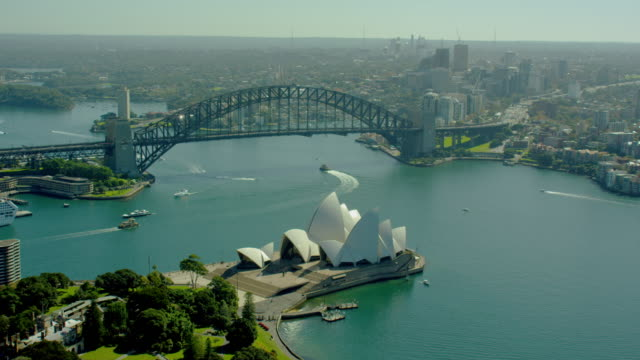vidéos et rushes de aerial view sydney harbor bridge and opera house - sydney