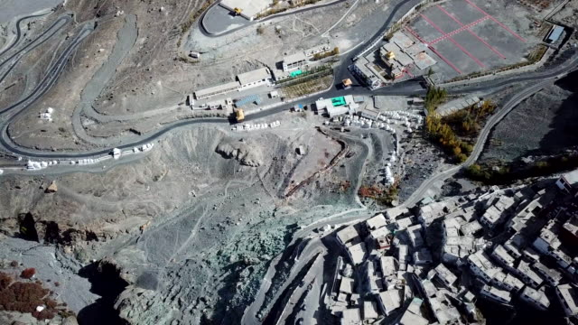 aerial view temple on himalayas mountain landscape near split of tectonic  at nubra valley, leh ladak,jammu & kashmir, india - frozen water stock videos & royalty-free footage