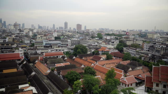 aerial view: temple roof among bangkok city covering fog - covering stock videos and b-roll footage