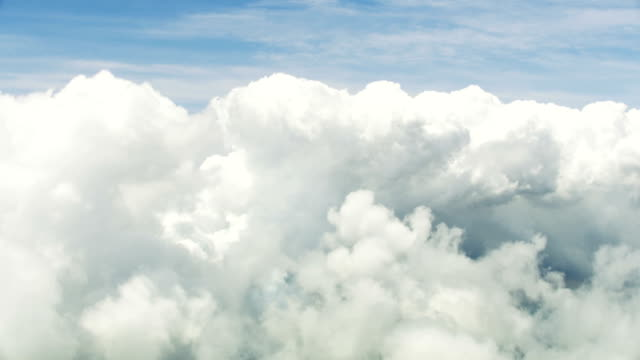 Aerial view textured sky floating white grey clouds