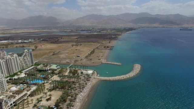 aerial view - the north beach of eilat with aquaba, gulf of eilat ,marina and hotels - red sea stock videos & royalty-free footage