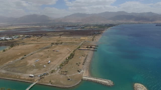 stockvideo's en b-roll-footage met aerial view - the north beach of eilat with aquaba, gulf of eilat ,marina and hotels - rode zee