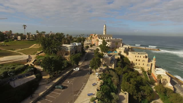 aerial view -  the old city of jaffa and the skyline of tel aviv - tel aviv stock-videos und b-roll-filmmaterial