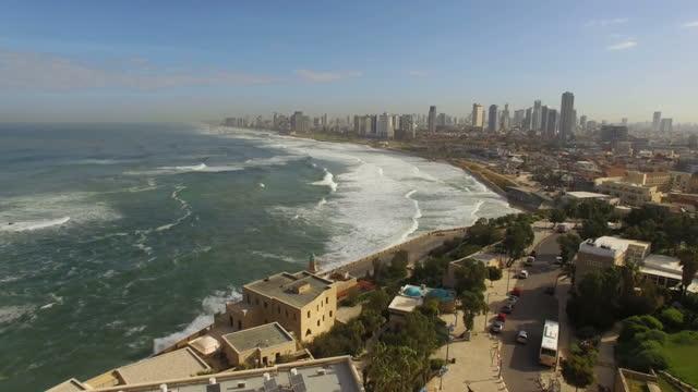 aerial view -  the old city of jaffa and the skyline of tel aviv - テルアビブ点の映像素材/bロール