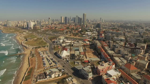 vídeos de stock e filmes b-roll de aerial view -  the old city of jaffa and the skyline of tel aviv - israel