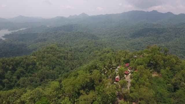 Aerial view the Pule Payung Tourism Hill attraction is seen in this aerial video taken above Kulon Progo Regency Special Region of Yogyakarta...
