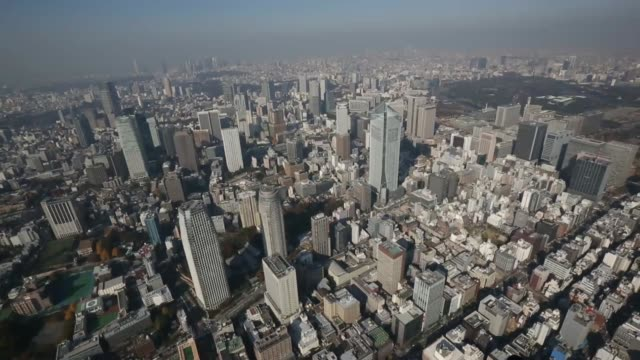 Aerial view the Rainbow Bridge in Tokyo Japan on Monday Dec 2 The Tokyo Tower stands amid buildings Commercial buildings stand in the Marunouchi area...