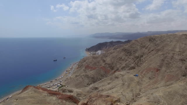 aerial view - the south beach of eilat with gulf of eilat , and hotels - spotted dolphin stock videos and b-roll footage