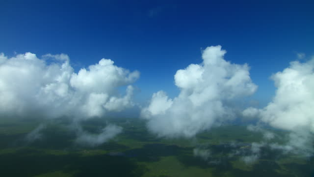 aerial view through clouds over the island of barbuda in the caribbean. - west indies stock videos & royalty-free footage