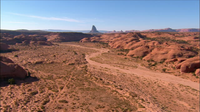 aerial view through mystery valley section of monument valley near kayenta / arizona - arizona stock-videos und b-roll-filmmaterial