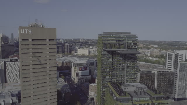 aerial view through university of technology sydney and one central park building. sydney australia - university stock videos & royalty-free footage