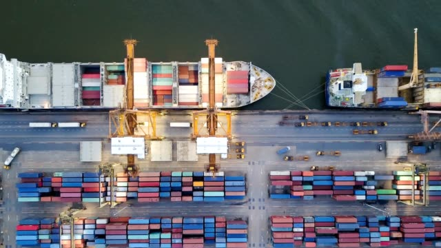 4k aerial view time lapse of modern industrial port with containers from top view - container stock videos & royalty-free footage