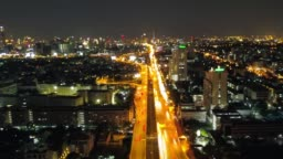 Aerial view time lapse of night traffic on a freeway