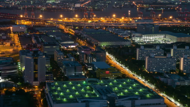 aerial view time lapse of osaka industrial zone at night - industrial district stock videos & royalty-free footage