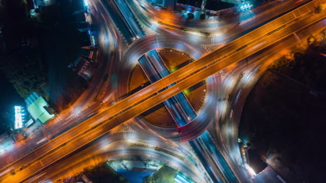 aerial view time lapse or hyper lapse motion of road traffic intersection,telecommunications and transportation concept - moving image stock videos & royalty-free footage