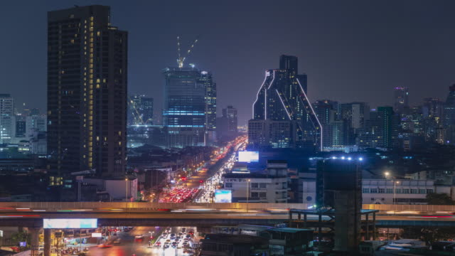 aerial view time lapse traffic road intersection for transport in bangkok. - roundabout stock videos & royalty-free footage