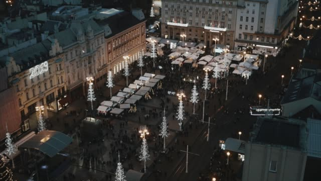aerial view time lapse zagreb city center during the christmas market during the night, croatia. - zagreb stock videos & royalty-free footage
