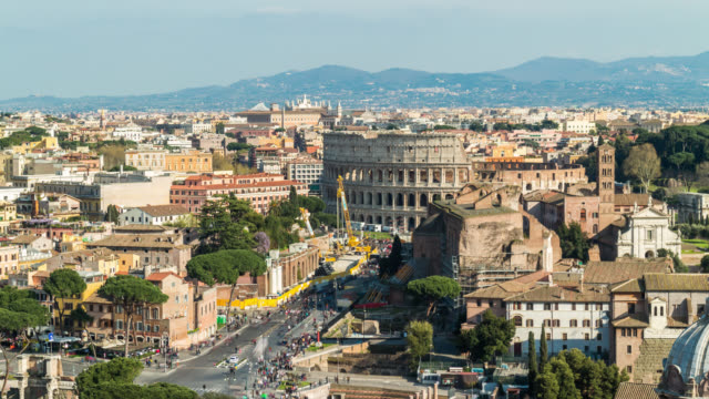 aerial view timelapse of famous ancient colosseum amphitheater from vittoriano at sunny day. rome, italy. april, 2016. - traffic time lapse video stock e b–roll