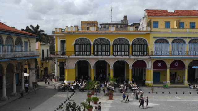aerial view timelapse of 'old plaza' or 'plaza vieja' in old havana cuba tourism in a unesco world heritage site in day havanacuba - plaza vieja stock videos and b-roll footage