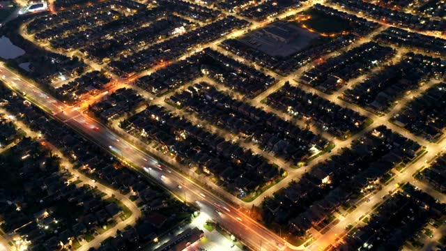 aerial view timelapse  of rutherford road and islington ave., detached and duplex house at woodbridge in vaughan, ontario, canada - dusk stock videos & royalty-free footage