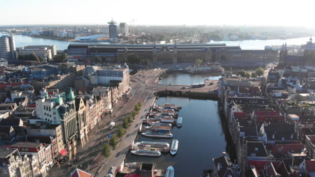 aerial view to amsterdam centraal station - canal stock videos & royalty-free footage