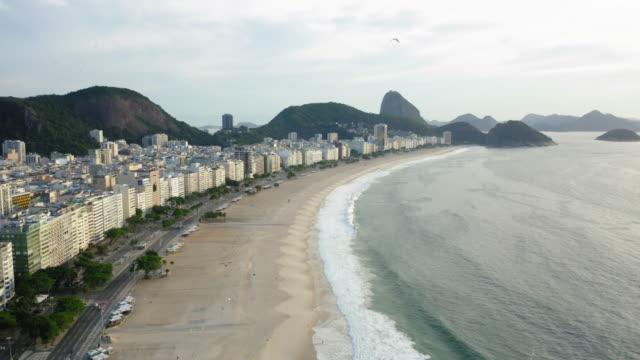 aerial view to copacabana beach, rio de janeiro, brazil - copacabana beach stock videos & royalty-free footage