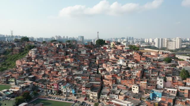aerial view to houses in the slum of paraisópolis, sao paulo, brazil - slum stock videos & royalty-free footage