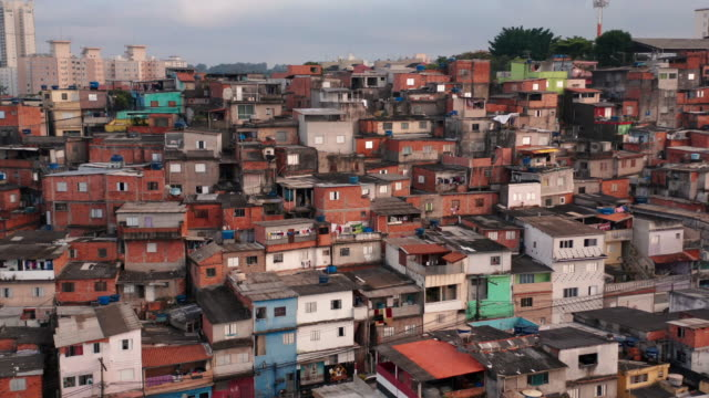 aerial view to houses in the slum, sao paulo, brazil - slum stock videos & royalty-free footage
