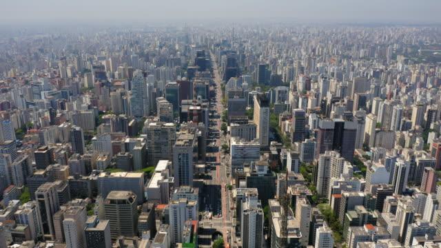 aerial view to paulista avenue and the buildings around, sao paulo, brazil - avenida paulista stock videos & royalty-free footage
