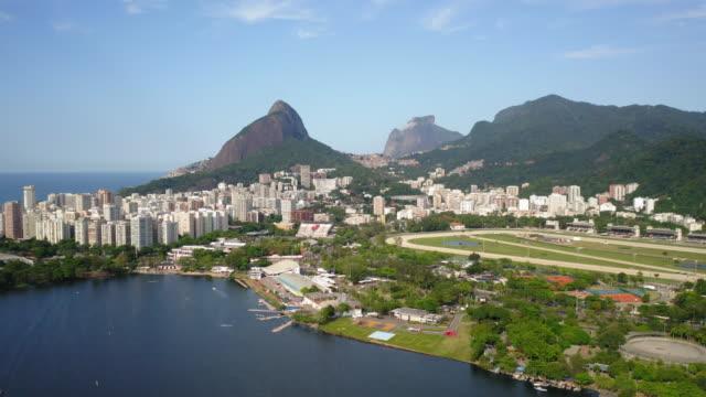 aerial view to rodrigo de freitas lagoon and the ocean in the background, rio de janeiro, brazil - lagoon stock videos & royalty-free footage