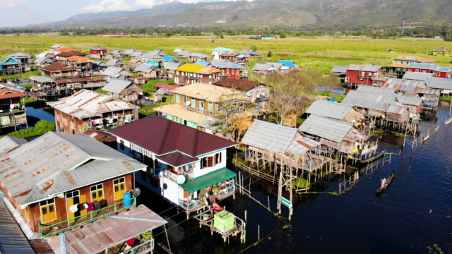 aerial view to the floating houses village in inle lake, myanmar - myanmar stock videos & royalty-free footage