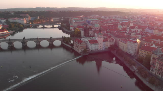 aerial view, to vltava river, the bridge and prague castle in prague - traditionally czech stock videos & royalty-free footage