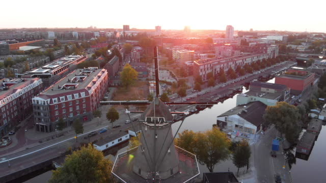 aerial view to windmill in amsterdam - amsterdam stock videos & royalty-free footage